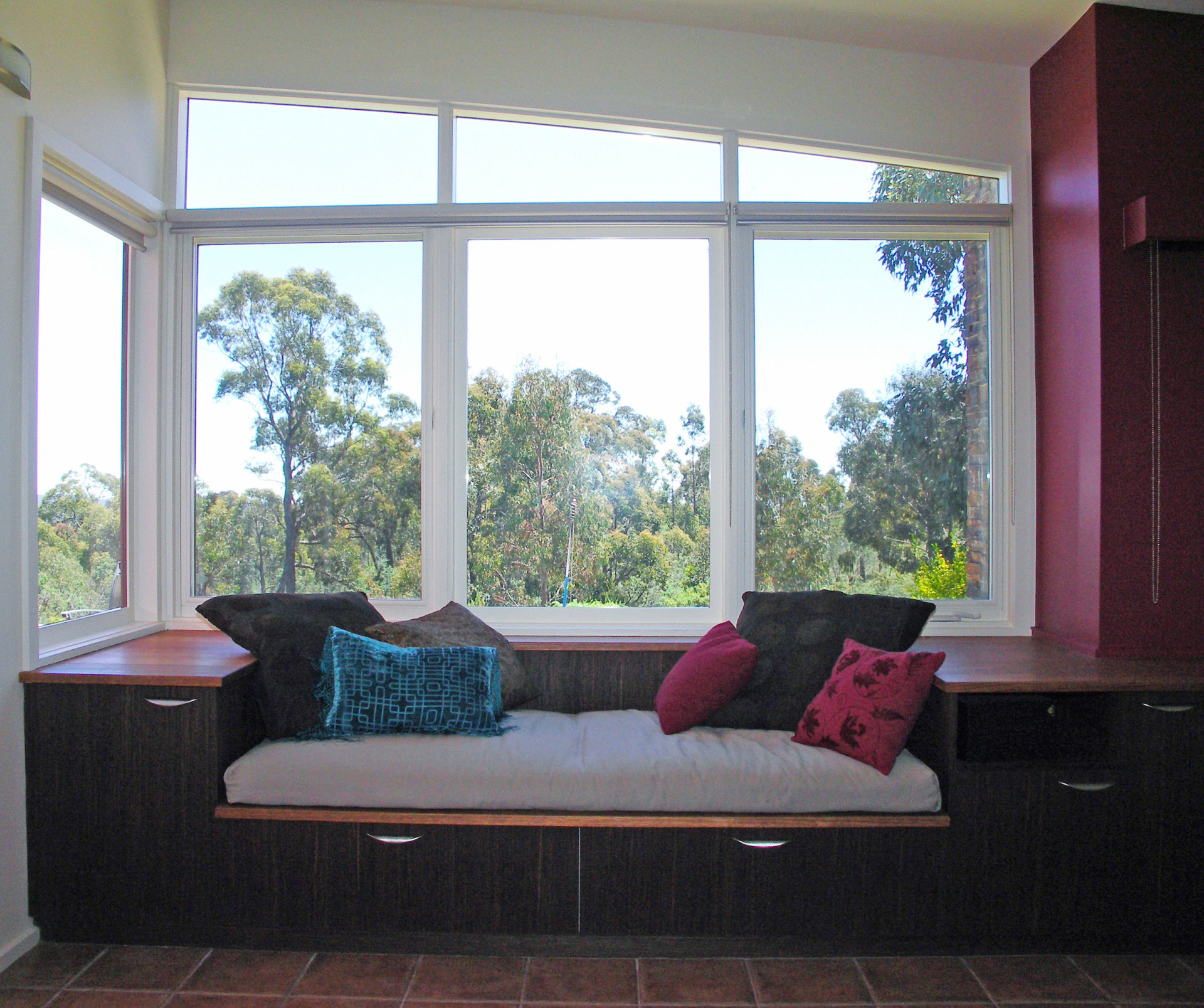 Hepburn House designed by sustainable architect Green Point Design. North-facing window-seat.