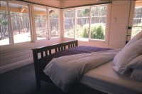 Blampied House designed by sustainable architect Green Point Design. Signal box bedroom.