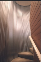 Blampied House designed by sustainable architect Green Point Design. Rainwater tank staircase.