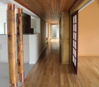 Hepburn House designed for Bushfire Category Flame Zone. Designed by sustainable architect Green Point Design. Timber lined hall.