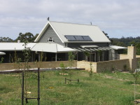 Lavers Hill House designed by sustainable architect Green Point Design. Sheltered courtyard.