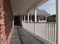 House designed by sustainable architect Green Point Design. Entry ramp for wheelchair.