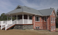 House designed by sustainable architect Green Point Design. Entry deck.