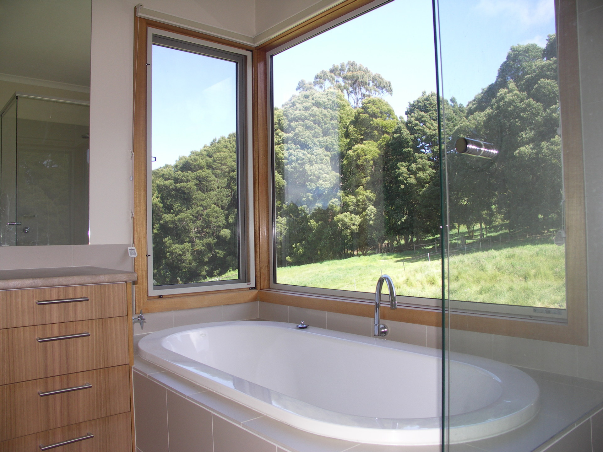 Lavers Hill House designed by sustainable architect Green Point Design. Bathroom with a view.