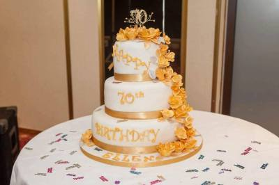 3 tier cake with edible cascading roses