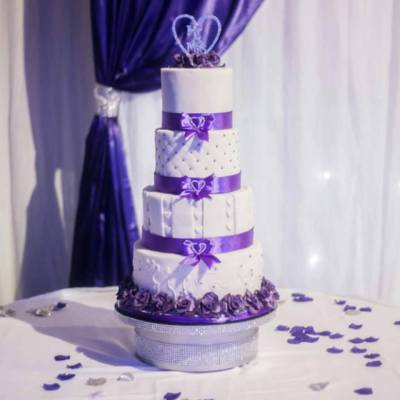 4 tier double height wedding cake with edible flowers