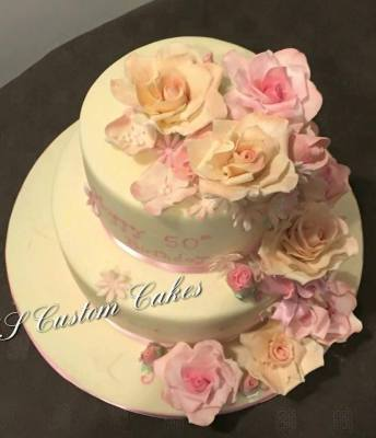 Two tier cake with edible cascading flowers