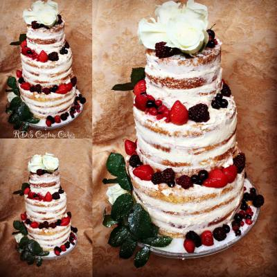 Semi naked wedding cake with fresh fruit and flowers