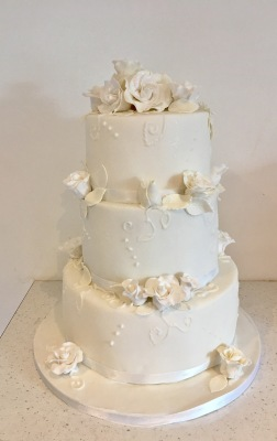 Classic white 3 tier wedding cake with edible rose
