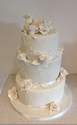 Classic white 3 tier wedding cake with edible roses