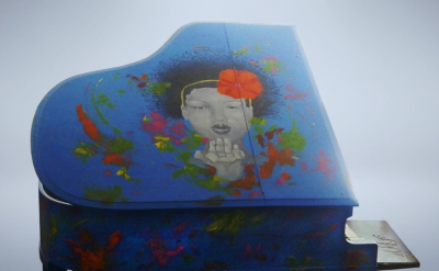 "A Kiss For Peace - Mix media painted over piano - Made for ""Pianos For Peace"""