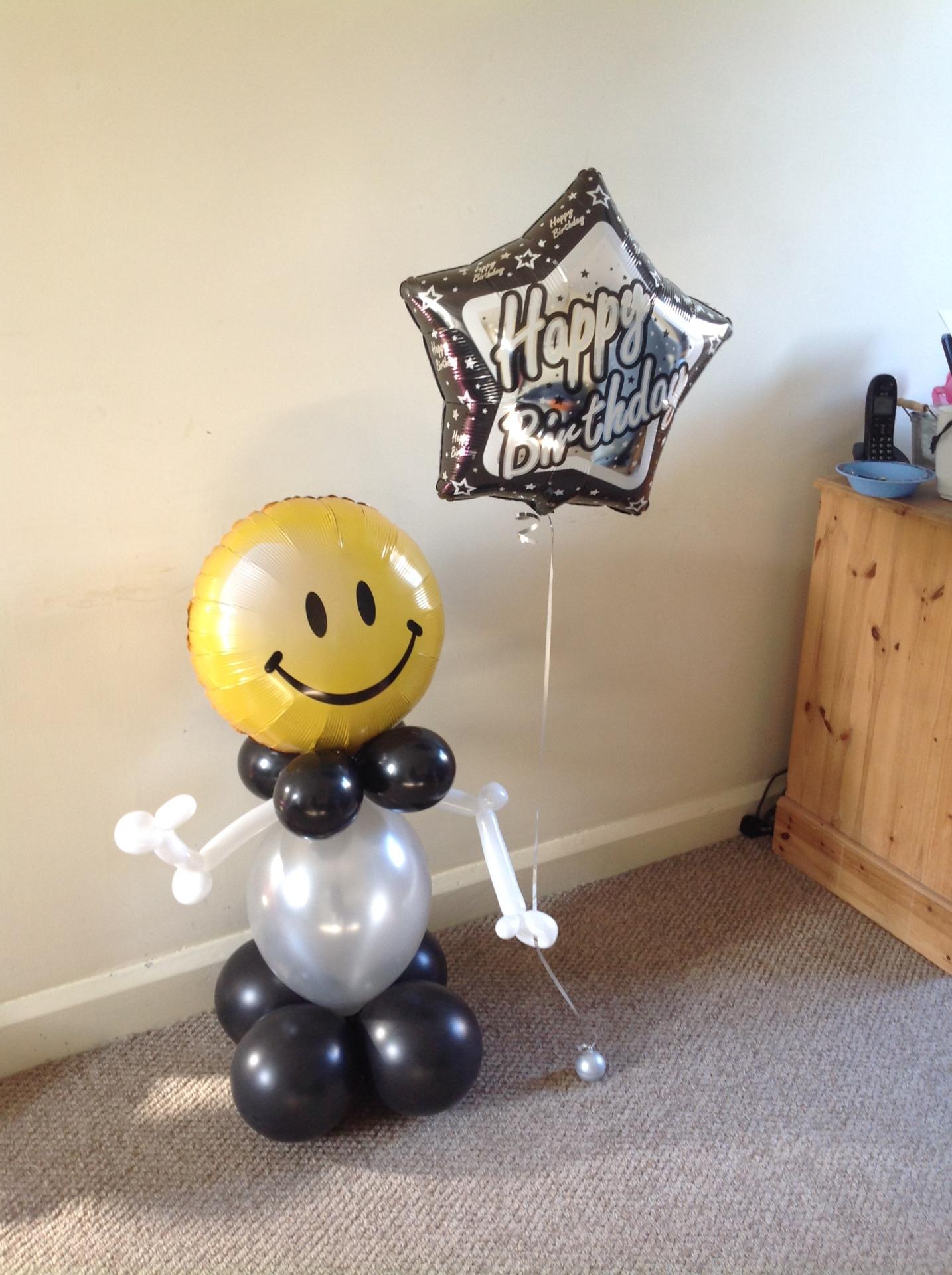 Balloon man holding a birthday balloon