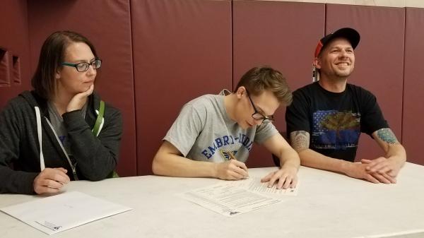 Josh Nira signs his scholarship to Embry-Riddle Aeronautical University
