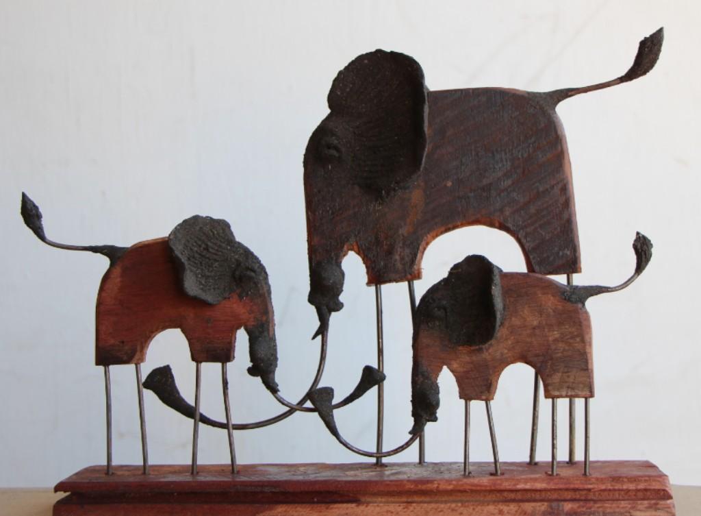 hand made elephant family carving