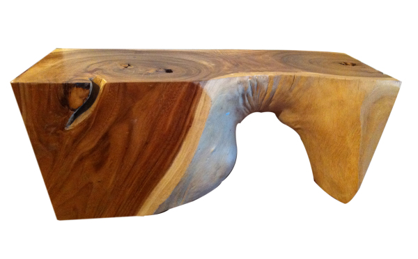 thick natural wood coffee table with an organic shape
