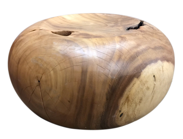 plump coffee table or seat made with tropical hardwood