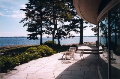 a stone patio overlooking a maine harbor originally designed by Isamu Noguchi.