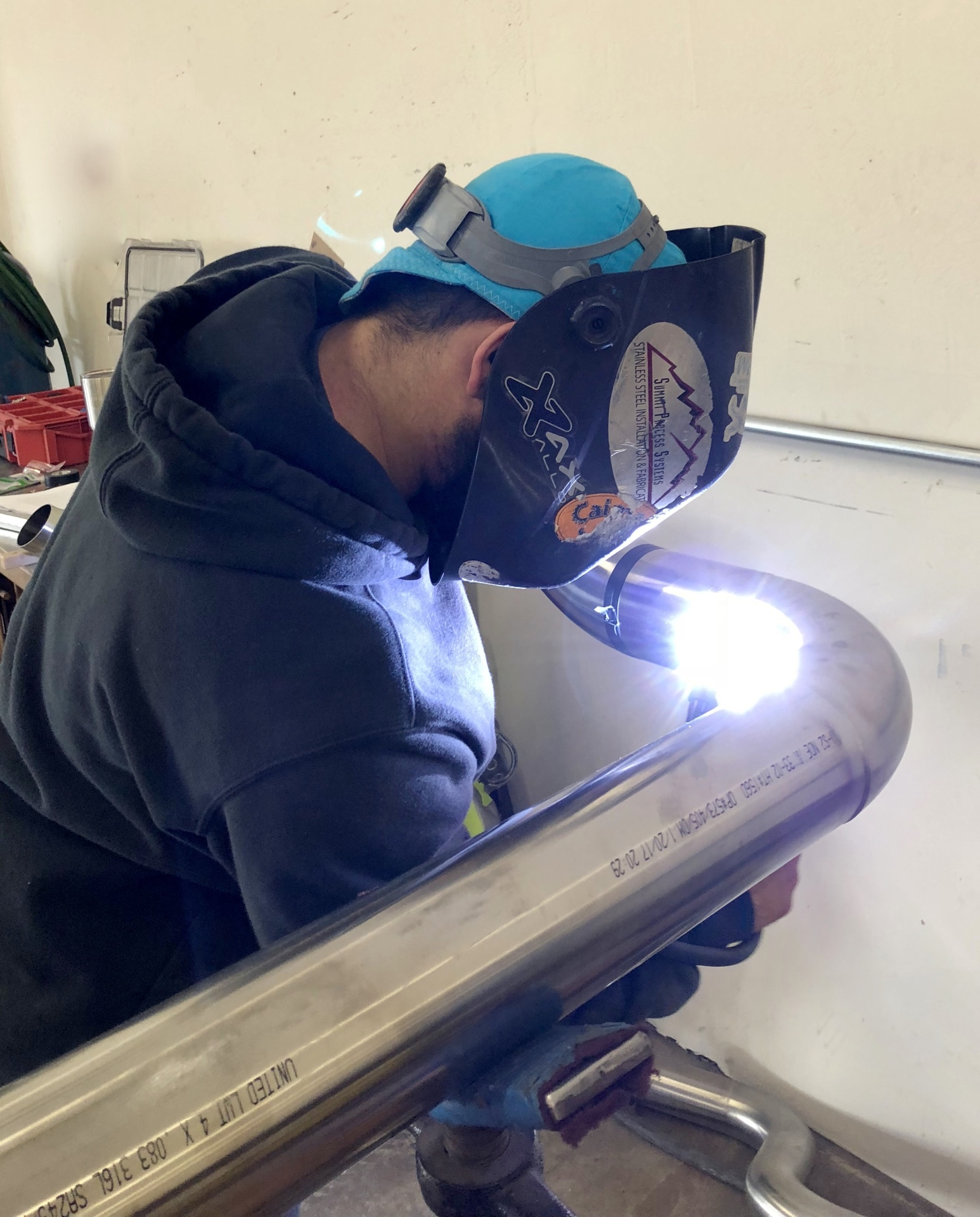 In-shop welding of pre-fabricated piece for a customer's piping project.