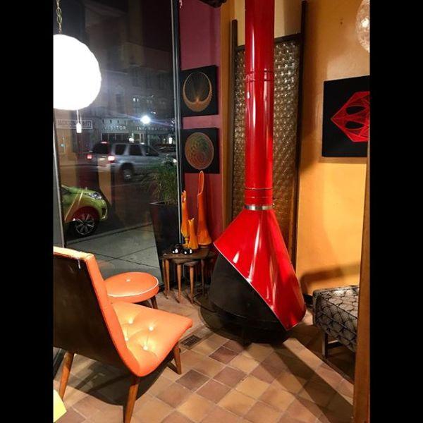 Orange Vinyl Scoop Chair & Red Atomic Fireplace