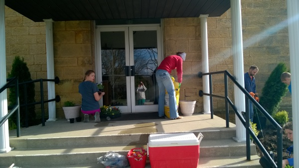 Lesley (right) and Stella (left) Hubert refilling the planters.