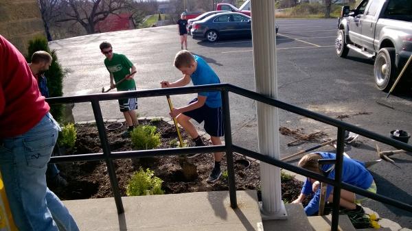 (left to right) Steven Beckman, Logan Hubert, & Hannah Hubert preparing the ground for plants.