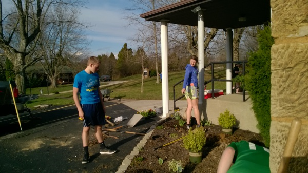 Logan and Hannah Hubert making sure the plants are lined up correctly