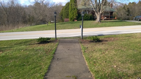 The large old bushes were replaced by smaller ones, revealing the old lightposts