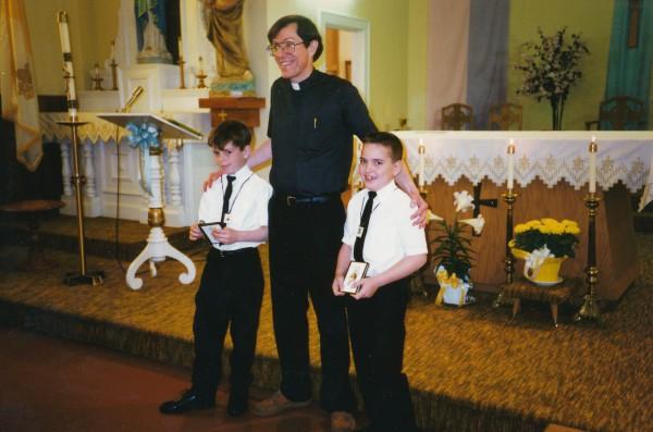 James Kloeppel and Chris Pollard with Fr. Isaac McDaniel