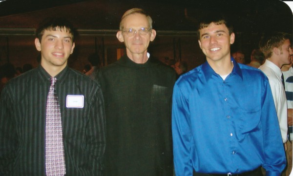 Philip and Jonathan Flamion with Father Guy