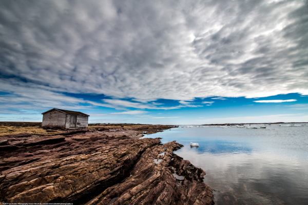 Shed, Water, Rocks, Reflection, CLouds, White, Grey, Blue