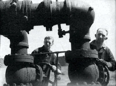 Operating the valves to release a cargo of oil for shuttle service. Nearly 17 million barrels of petroleum were shipped.