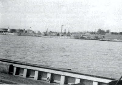 Ships loading at the shuttle service docks in Halifax Harbor, in the background is Imperial Oil's Halifax refinery.