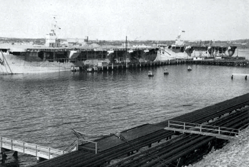 A cargo of oil being loaded at Halifax Refinery of Imperial Oil. Shuttle service took 16 billion barrels of oil to Great Britain.