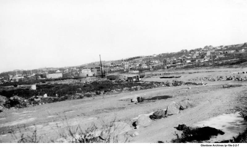 Looking north to (Eastern Passage Road) Pleasant Street from the Dartmouth Imperial Oil Refinery December 21, 1929