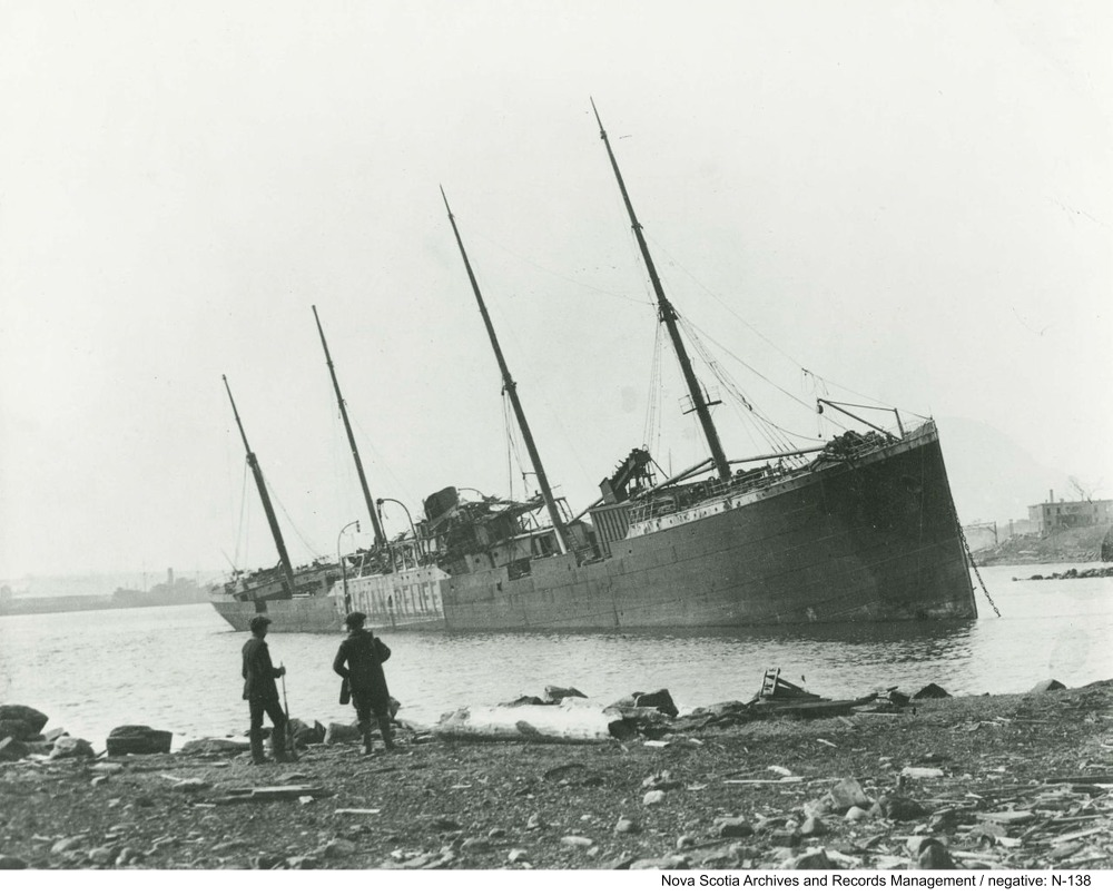 he Norwegian steamship SS Imo aground on the Dartmouth shore, after the Halifax Explosion, photographed December 31, 1917.