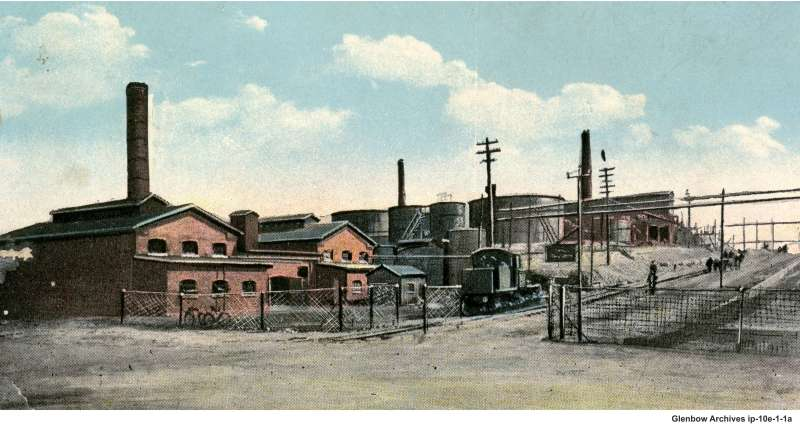 employees parked along Pleasant St. opposite the main gate, Imperial Oil's Imperoyal Refinery in Dartmouth, 1920s
