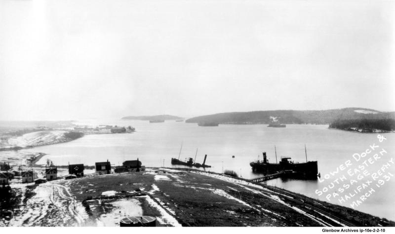 Looking east, the lower dock at Dartmouth's Imperial Oil  Refinery. Photographed in March 1931.