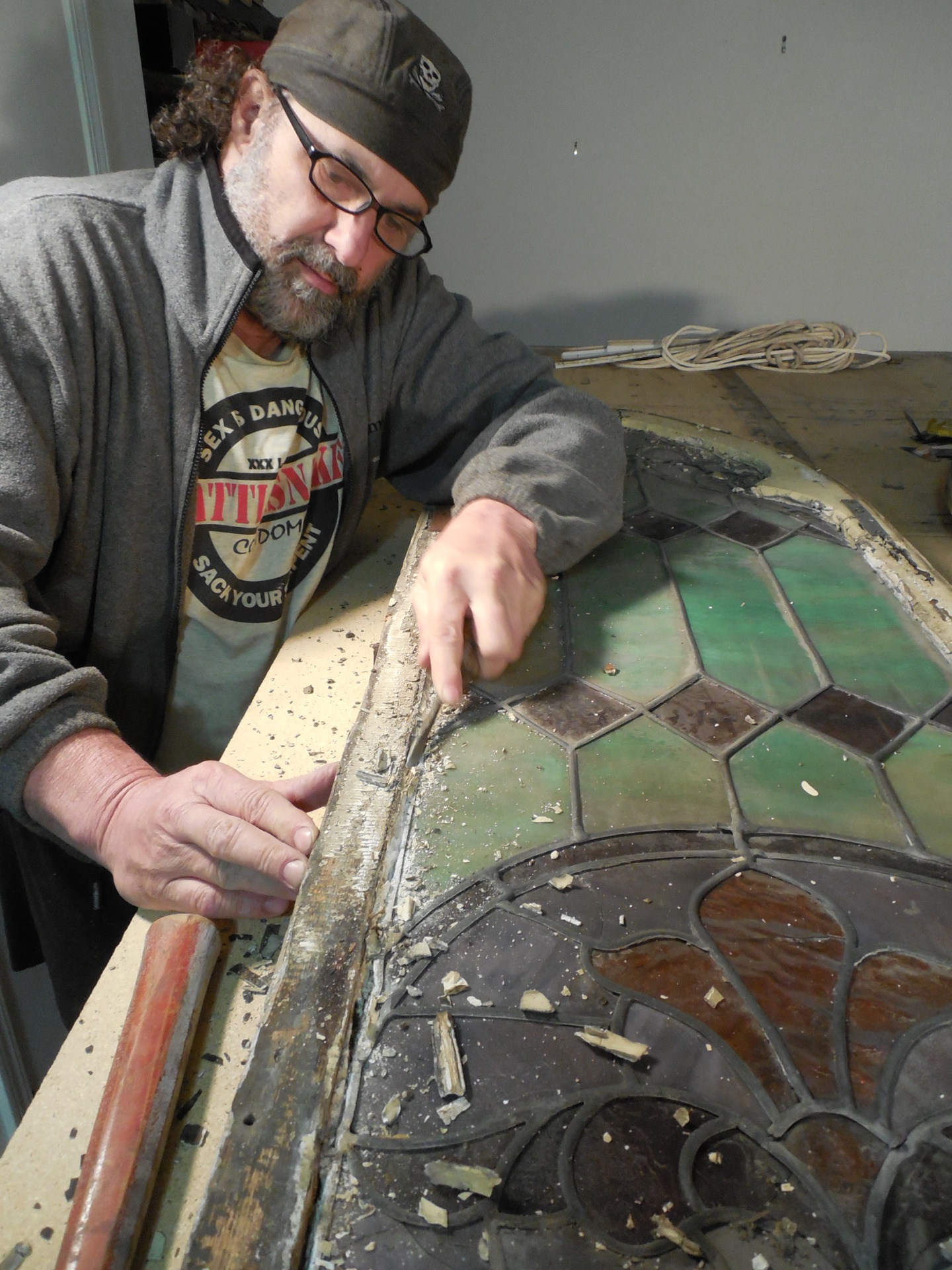 Gregory A.D. Greg Lashbrook restores a leaded glass church window
