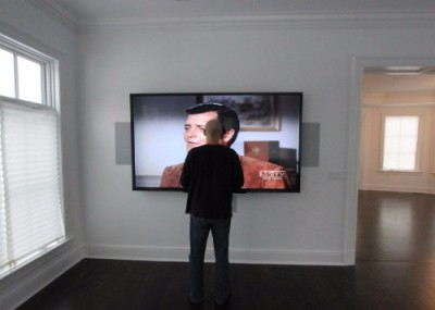 Audio & Video, picture of man in front of TV
