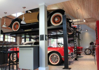 Picture of garage with car lifts and classic cars