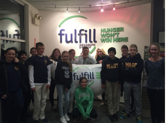 Student sort food at Fulfill Food Bank in Neptune