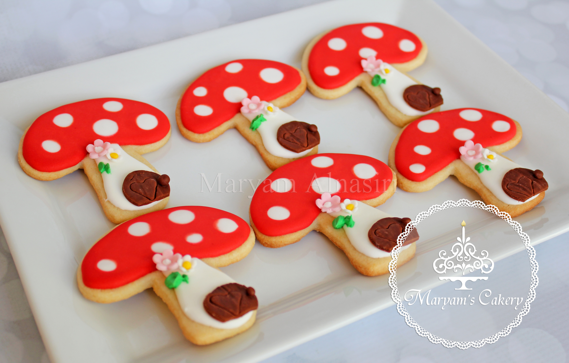 customized toadstool cookies to match the cake