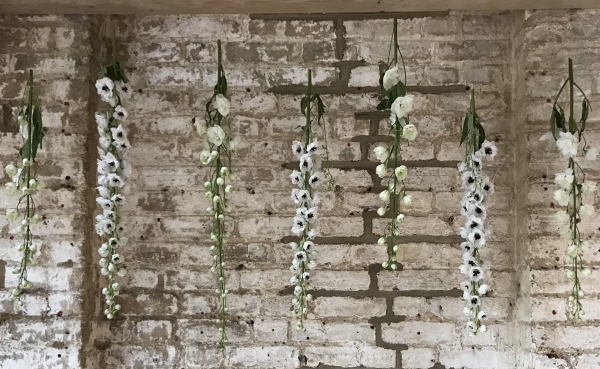 Hanging flowers| warehouse wedding | foliage wedding | London wedding | london florist