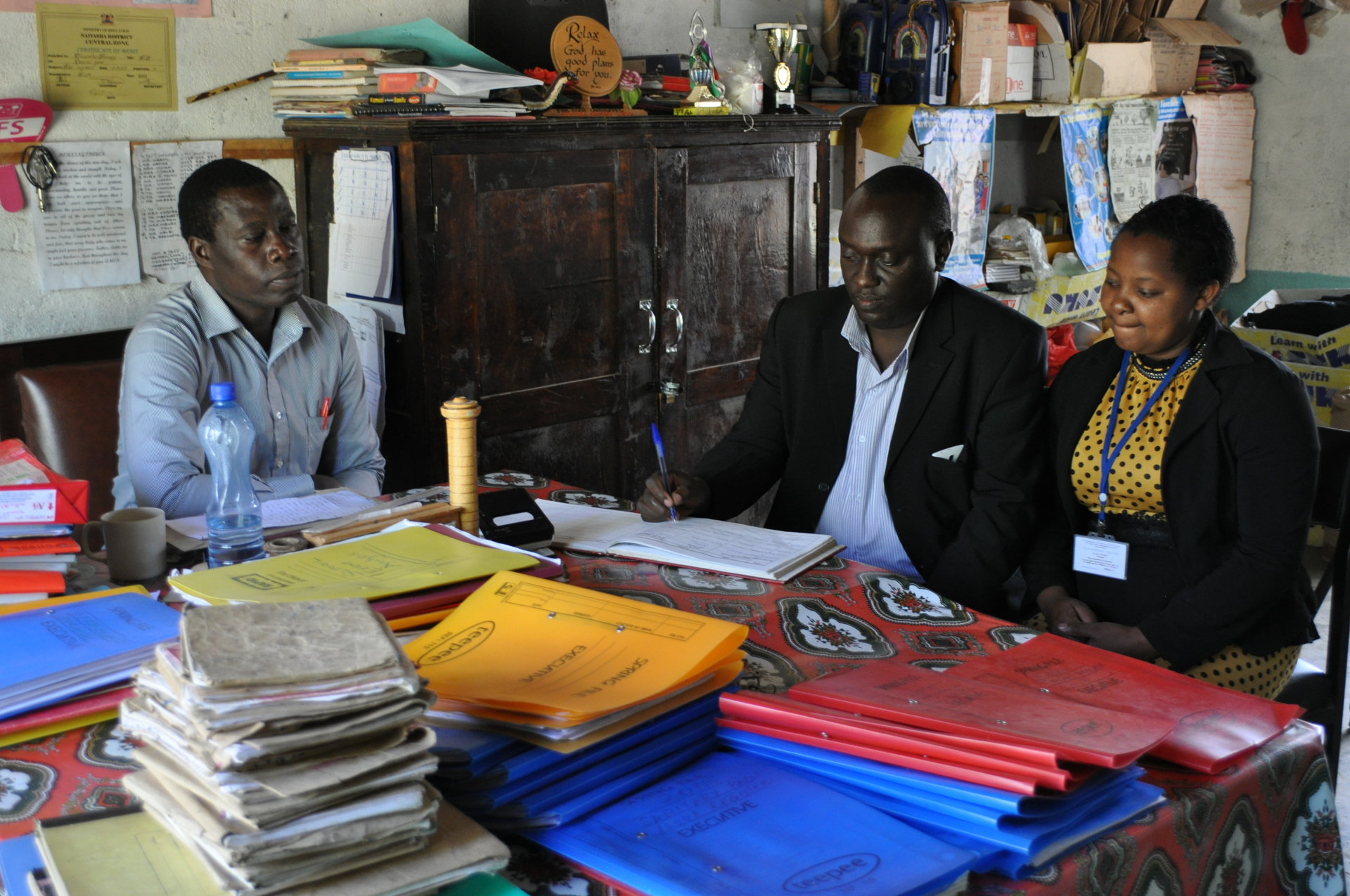 Deputy Head Teacher (left) with ASN Upendo Village Child Welfare Officer, Samuel Maina, and Assistant Child Welfare Officer,  Patricia Mwaura