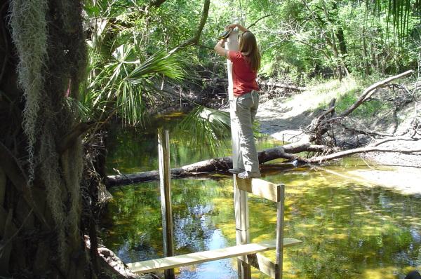 Laura collecting water velocity data