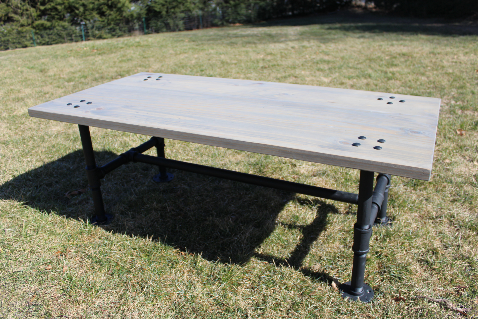 Industrial Coffee Table with Steel Pipe Legs and Rustic Charm