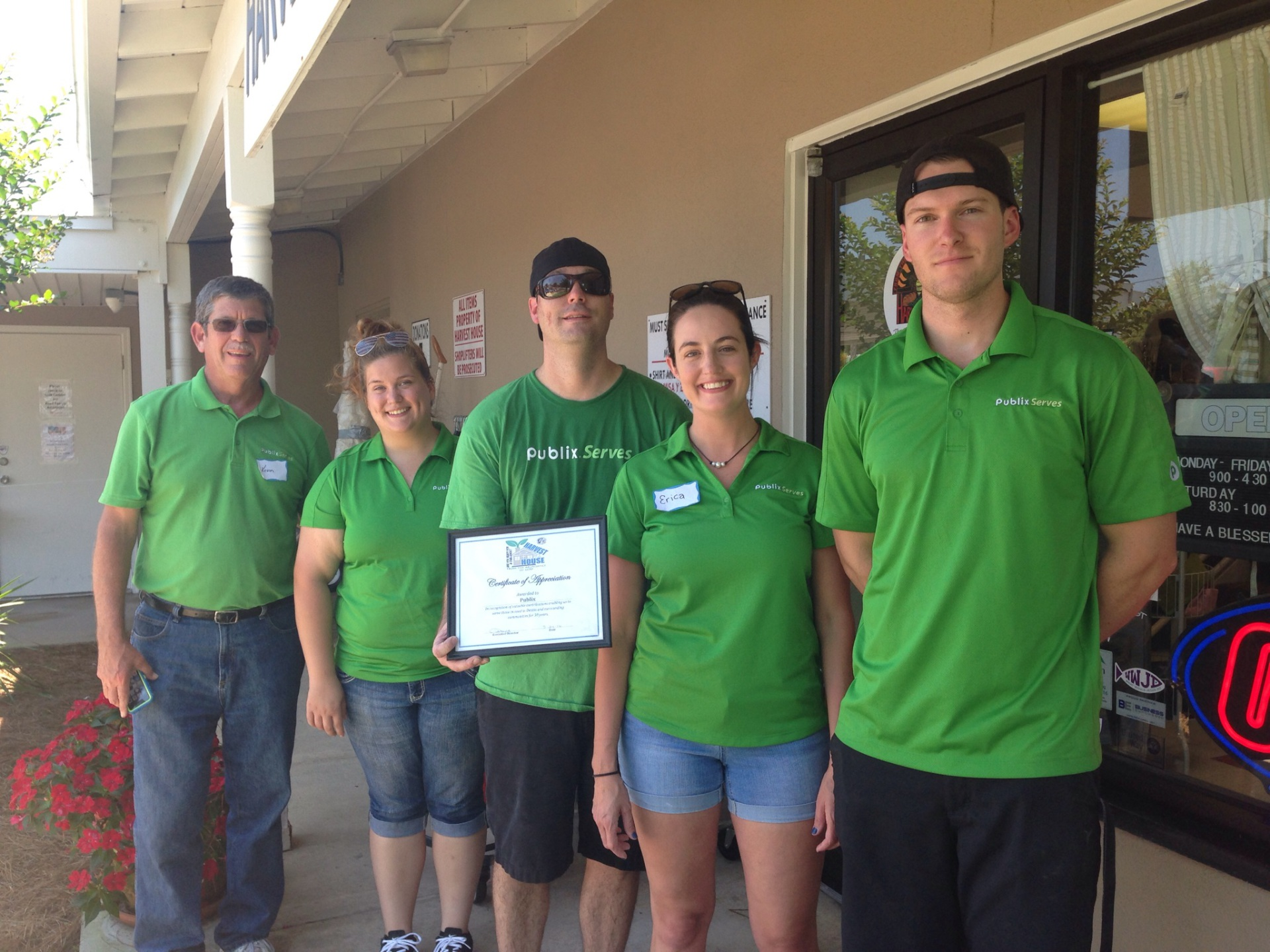 PUBLIX SERVES donating their time to help the Harvest House