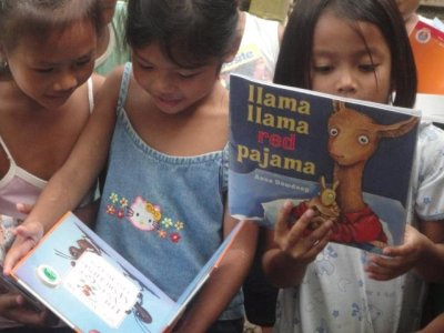 We (through your donations) are able to help these children have books.