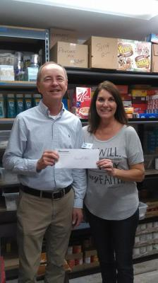 Paul from BancorpSouth donating to our Food Pantry during the holiday season