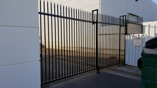 Dual slide iron gate